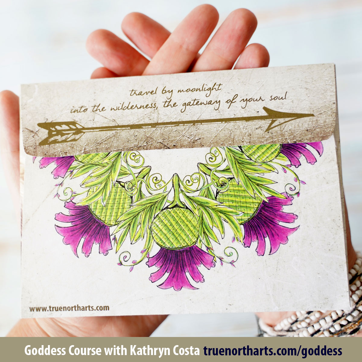 The back side of the Artemis envelope features her famed arrow and a mandala made of thistles.